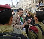 Palestinian Ziad Abu Ein, Head of the Anti-wall and Settlement Commission, argues with Israeli soldiers as they prevent him from crossing to Al-Shuhada Street in the West Bank city of Hebron